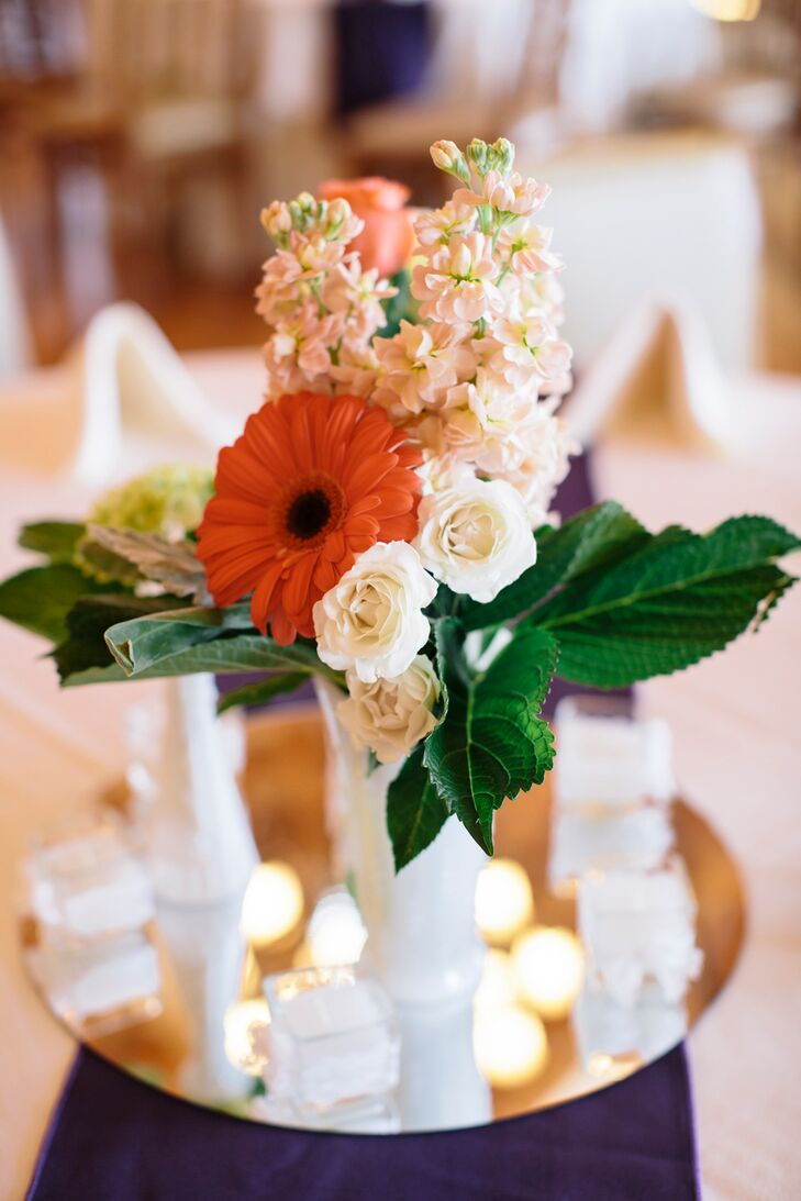 """My step mom and dad sell antiques and their milk glass vases were the inspiration for our centerpiece,"" says Juli."