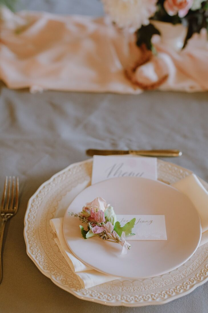 Place Setting with Romantic Dinnerware, Place Card and Rose