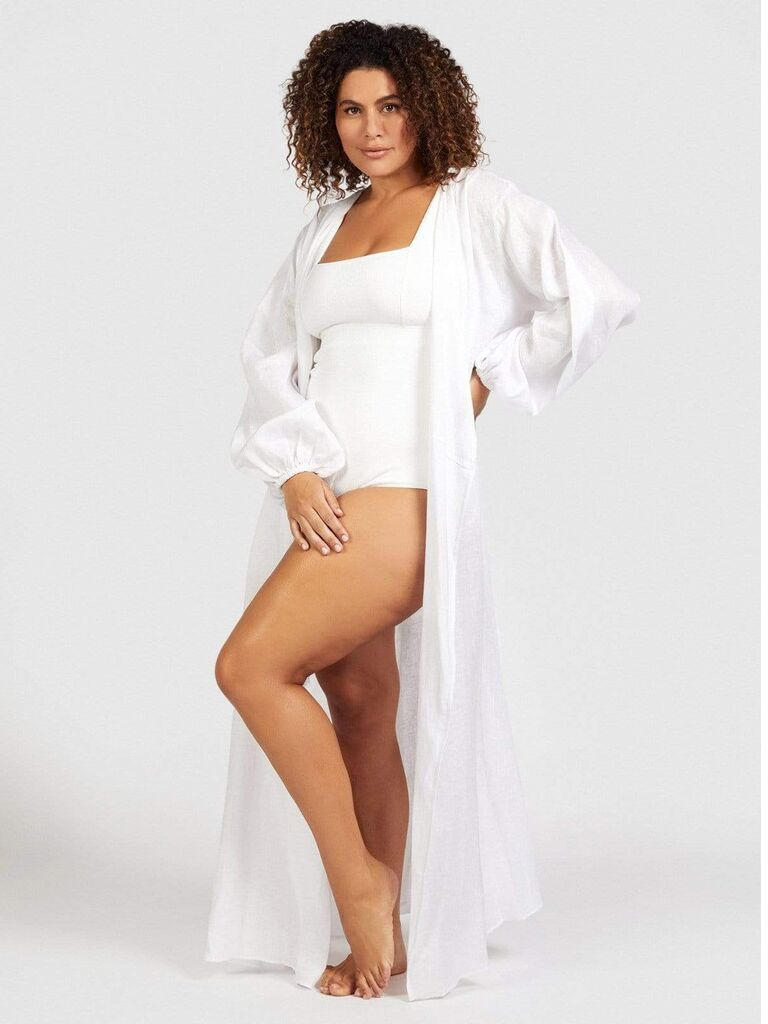 Structured white simwsuit and long white cover-up