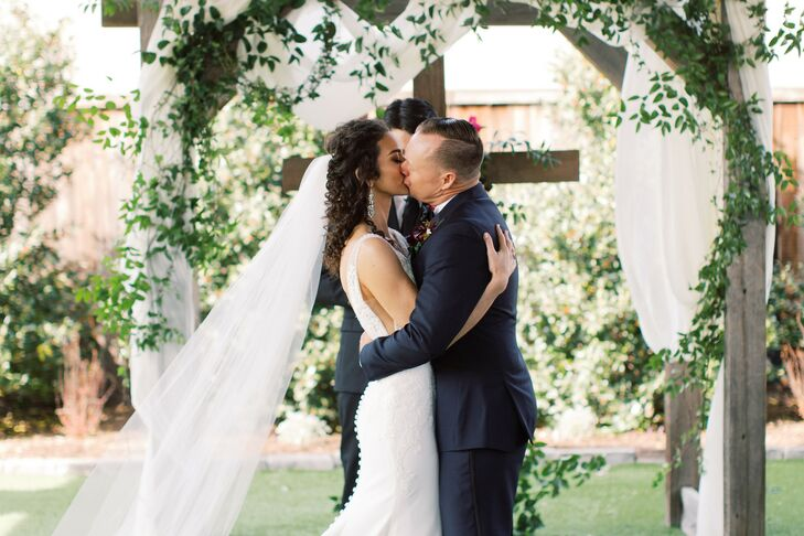"Heather and Travis wanted to re-create the whimsical feeling of an English garden for their wedding. ""Faith and family are the two most important aspe"