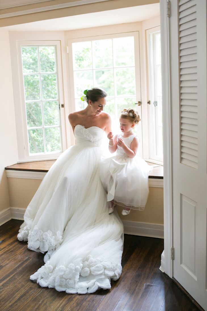 Sarah's first job out of college was as a bridal consultant at Vera Wang, so it was important for her to find a one-of-a-kind dress. She fell in love with her strapless Prestigio by Manuel Mota gown while browsing through a bridal magazine.