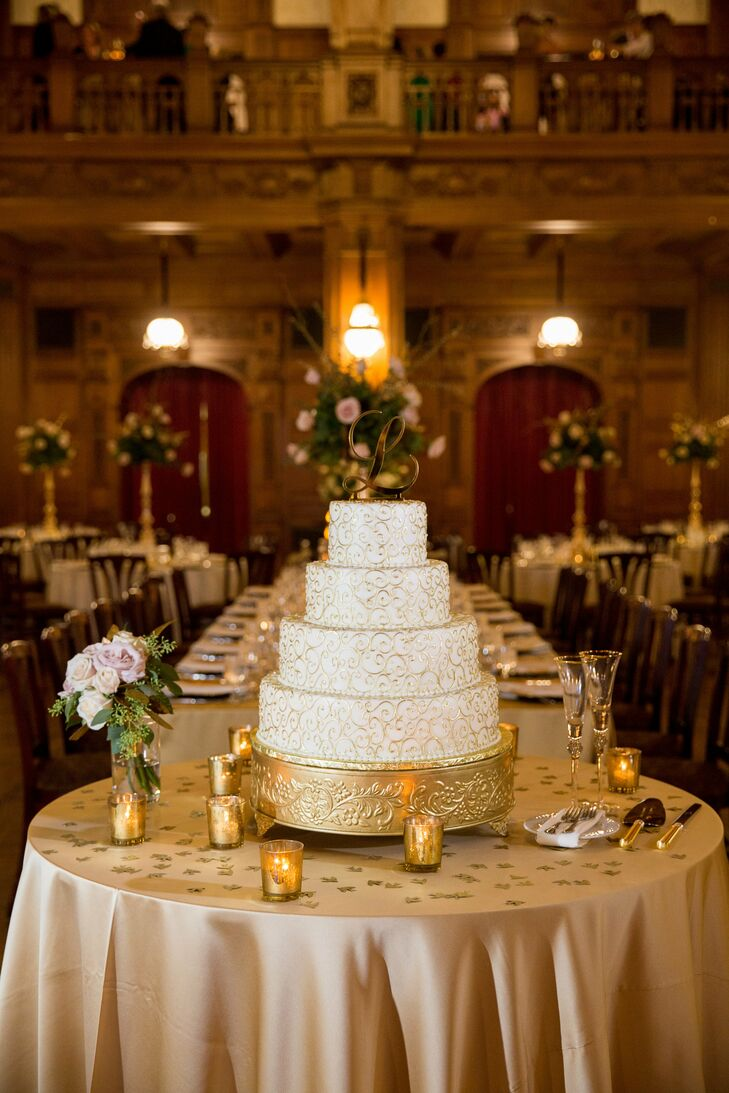 "The metallic gold icing was what sold Sarah on this elaborate wedding cake. ""It was the perfect complement to our theme,"" she says. And the spice flavor ""was to die for."""