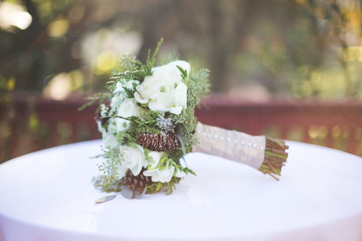 Roxanne's bouquet included winter white flowers with pinecones and greenery to reflect the winter theme.