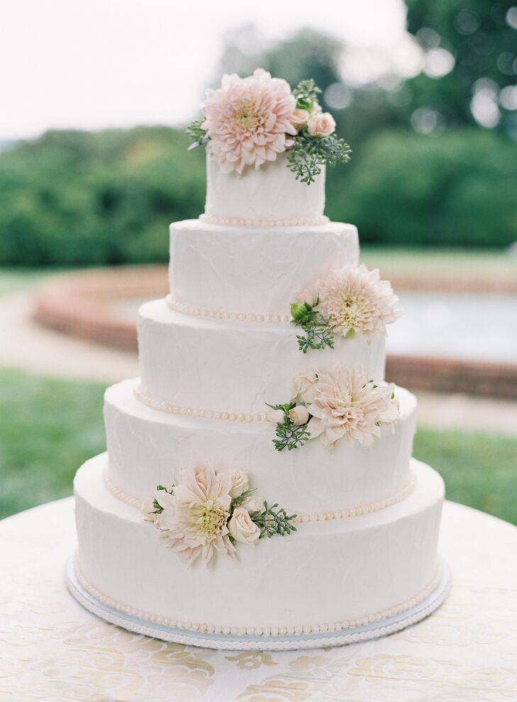 "Elizabeth and Philip served a five-tier carrot cake finished with cream cheese frosting and fresh flowers. ""We wanted a cake that was delicious in addition to being beautiful,"" Elizabeth says. ""I only wish I had gotten to finish my piece!"""