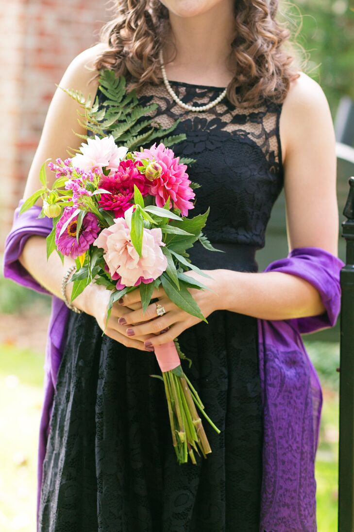 The bride and groom enhanced their black, pink and purple color palette with local fresh flower arrangements made by family friends.