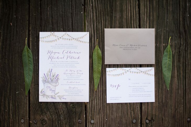Hand-Painted Weddings created a pretty lavender invitation suite for Megan and Mike's wedding. The invites featured a motif of a pail of lavender with the couple's monogram on it. They also also had string light borders on the top.