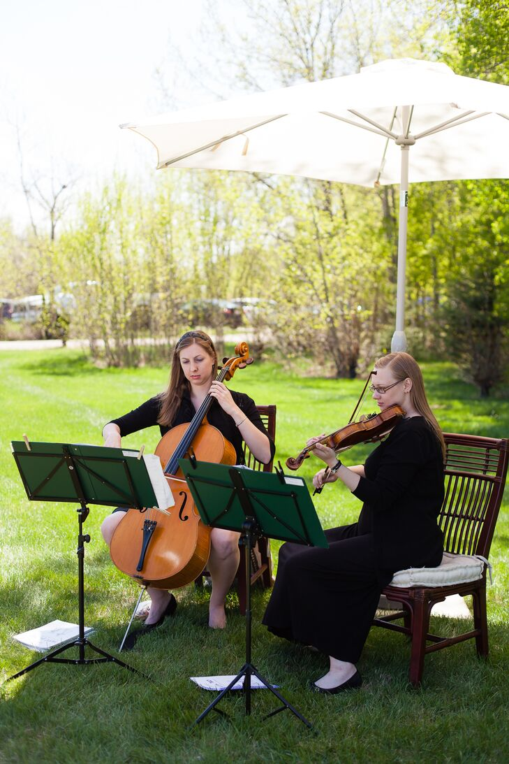 A string duo provided music for the outdoor ceremony.