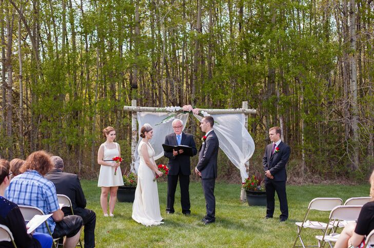 The couple exchanged vows in front of a birch branch arch that Nicola's father built.