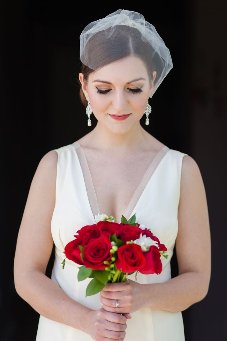 Nicola carried a gorgeous red rose bouquet, which complemented her vintage inspired look perfectly.