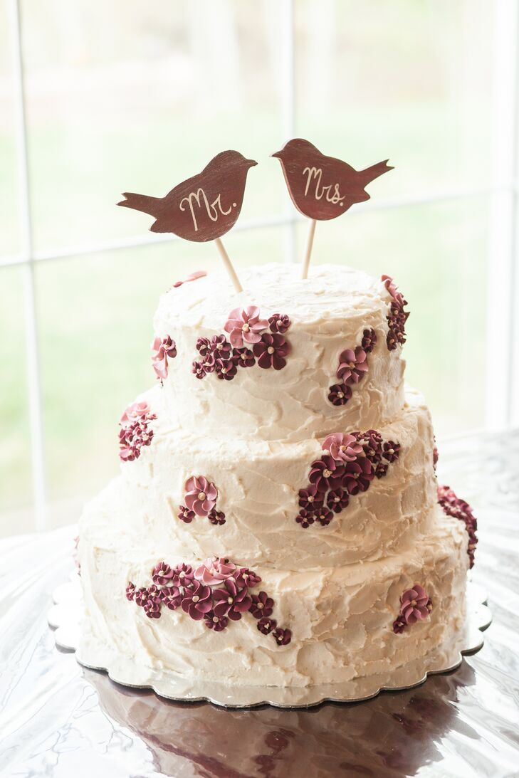 The couple's three tier cake was topped with cute wooden Mr and Mrs bird cake toppers.