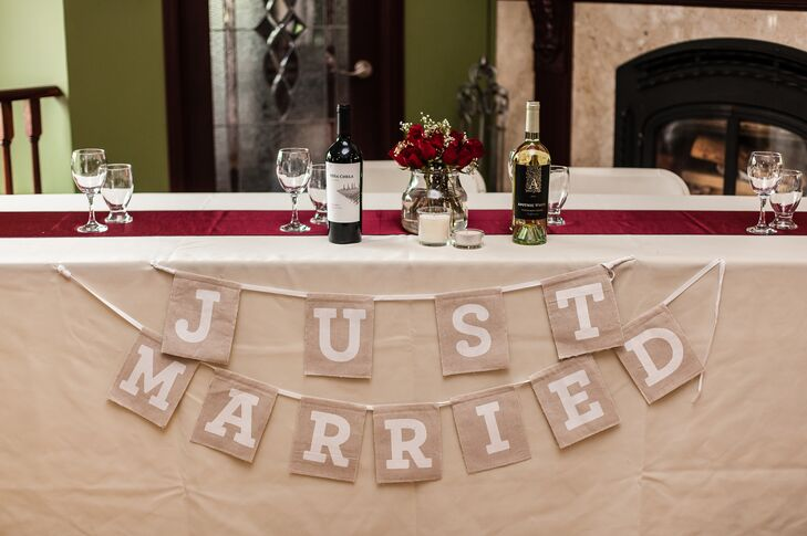 A neutral color just married sign was strung across the front of the head table.