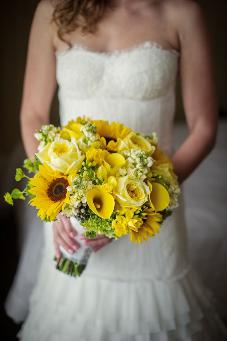 Jessica's bridal bouquet captured the event's cheerfulness and the summer season's essence. The sunny yellow arrangement was designed by the talented team of florists at Fleur de Lys and was filled with a fresh mix of garden roses, calla lilies, sunflowers and stock.