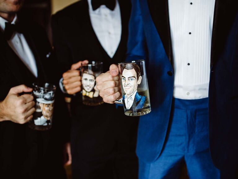 Groom and groomsmen holding personalized mugs