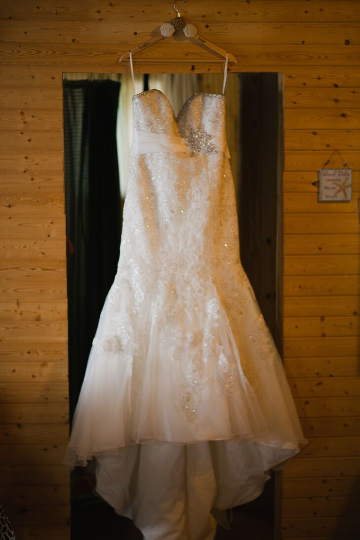 Heather's Mori Lee wedding dress had a sparkly lace overlay and a sweetheart neckline.
