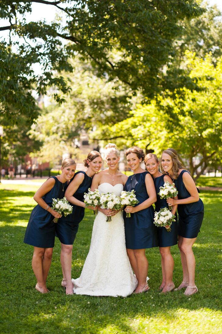 Maggie's five bridesmaids donned sophisticated navy blue dresses with open backs. They also wore different necklaces from designer Erin McDermott.
