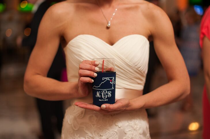 The bride's sister made wedding koozies for guests to take home that incorporated the bride's hometown in Virginia, the groom's upbringing in Maryland and Washington, D.C. for bringing the couple together.