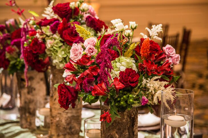 "Flower arrangements at the reception consisted of bold roses and lilies in addition to other exotic flowers. ""I wanted my money to be spent on the quality of my flowers rather than the quantity,"" Roxanne says."