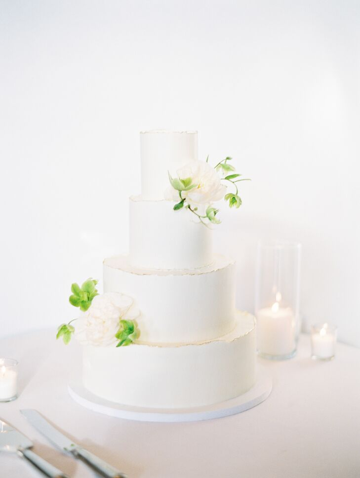 Modern White Wedding Cake with White and Green Flowers