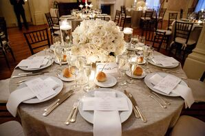 Champagne Table Linens With White Flowers and Candles