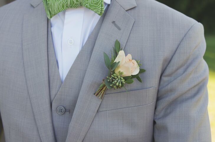 A peach rose and eucalyptus berries paired perfectly with Brendan's light gray suit.