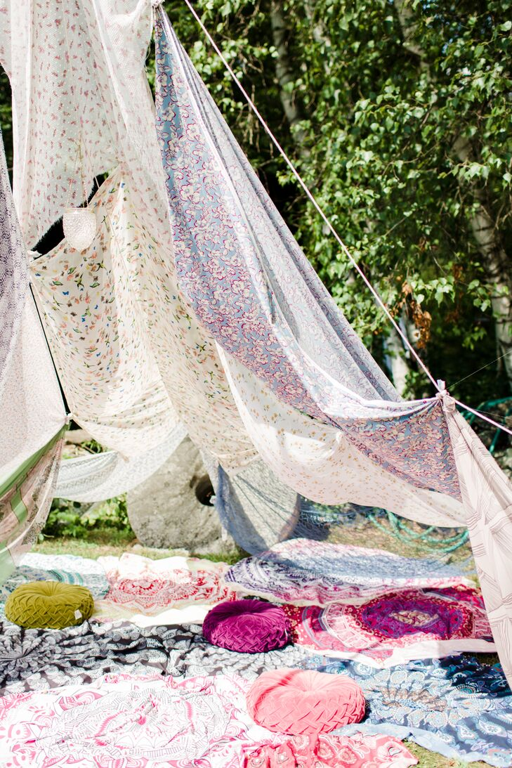 In lieu of a more traditional lounge, Nicole and Dor invited guests to kick back and relax under the shade of airy panels of floral-printed fabric, formed to create a cozy open-air tent.