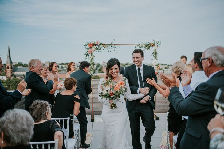 Simple Copper Wedding Arch Accented with Warm-Hued Flowers