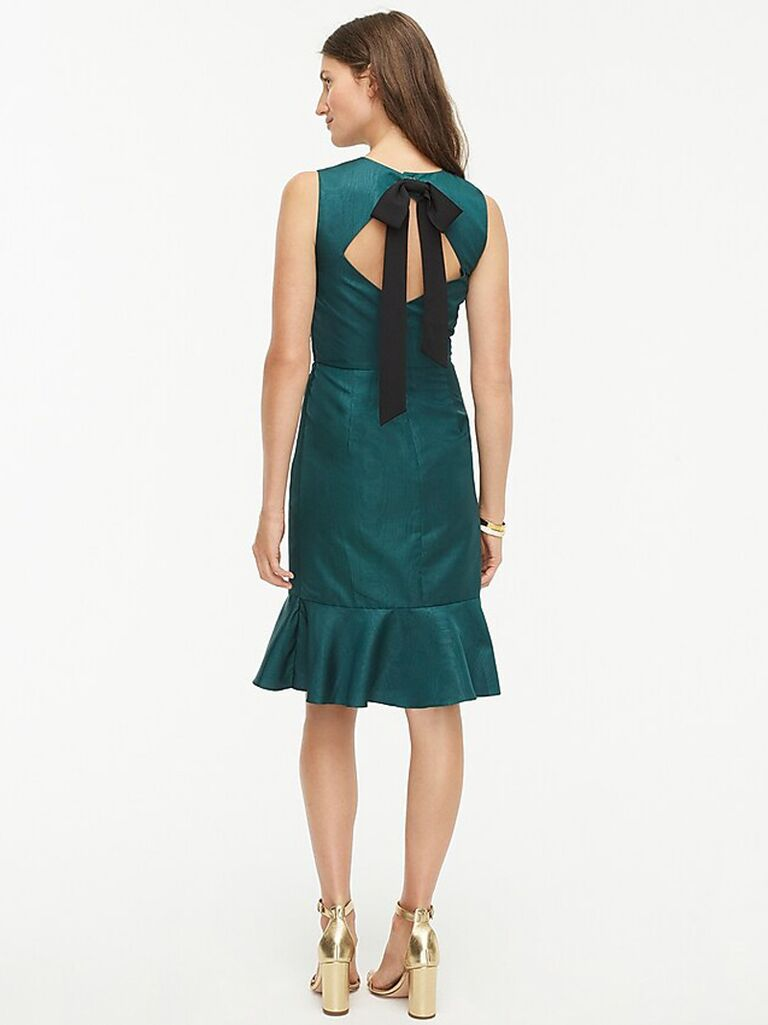 Green winter wedding guest dress with back bow