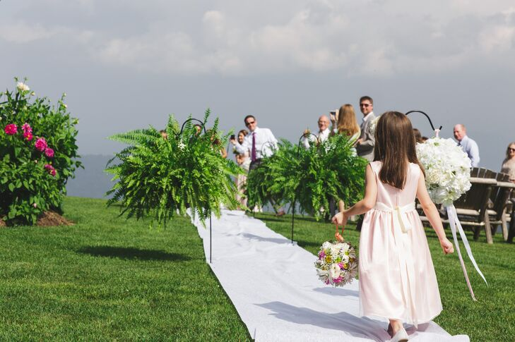 The flower girl provided guests with wedding program that contained personal letters the newlyweds had written for one another.