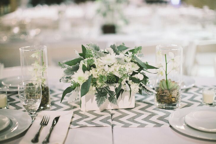 The centerpieces were a mix of white flowers and greenery that sat atop fun chevron runners.