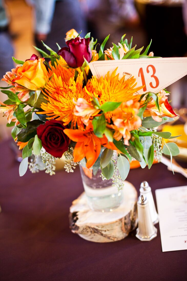 Orange and Green Centerpiece With Gold Flag Table Number