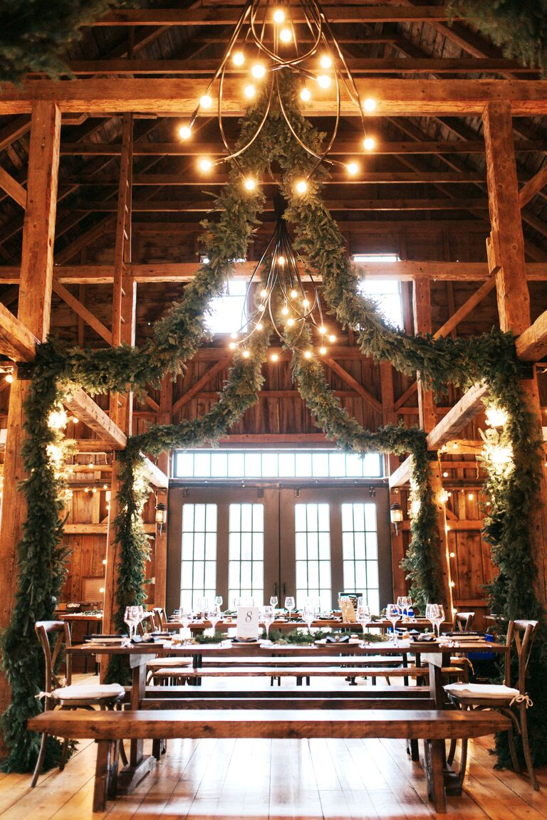 evergreen garlands at rustic wedding venue