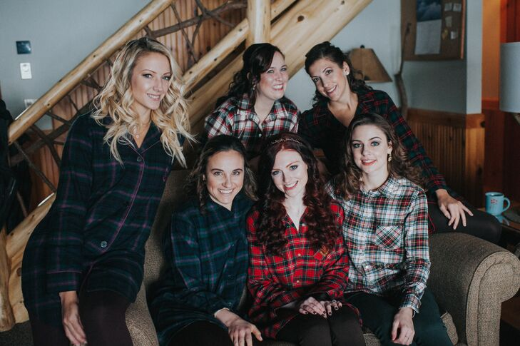 Cait and her bridesmaids prepped in cozy flannel shirts.