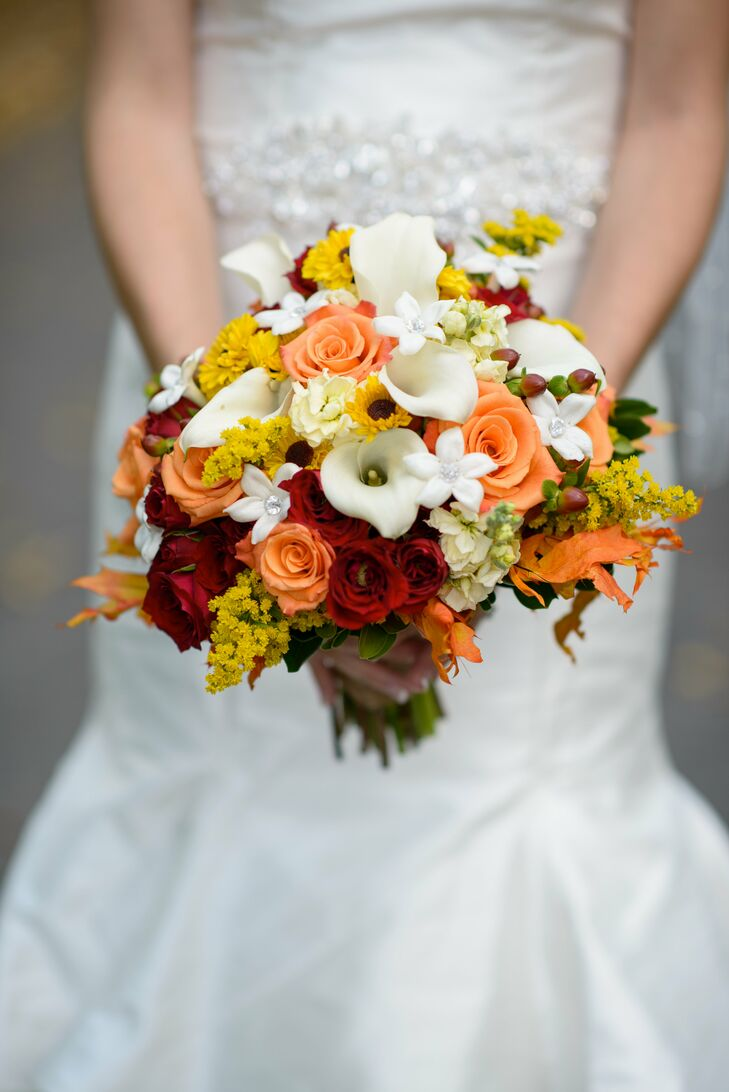 Elysa carried a bouquet with peach and red roses, white calla lilies, white stephanotis and yellow flowers.