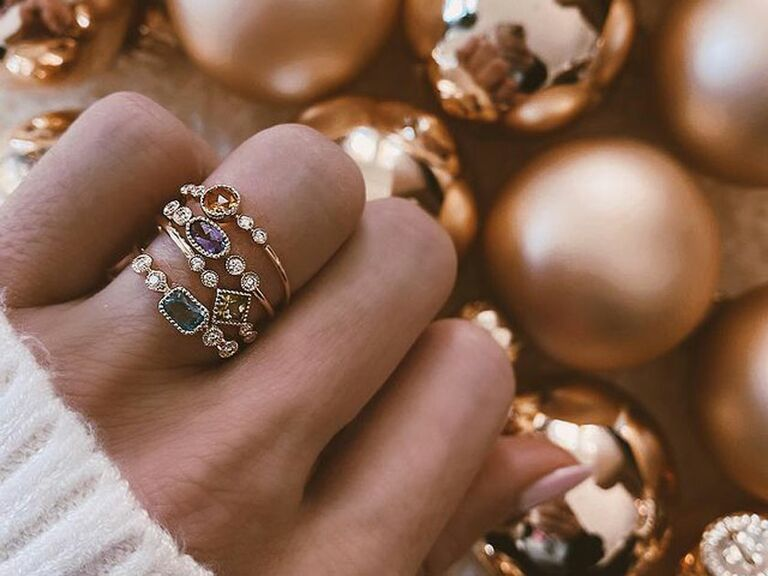 Colored stacked wedding bands on finger