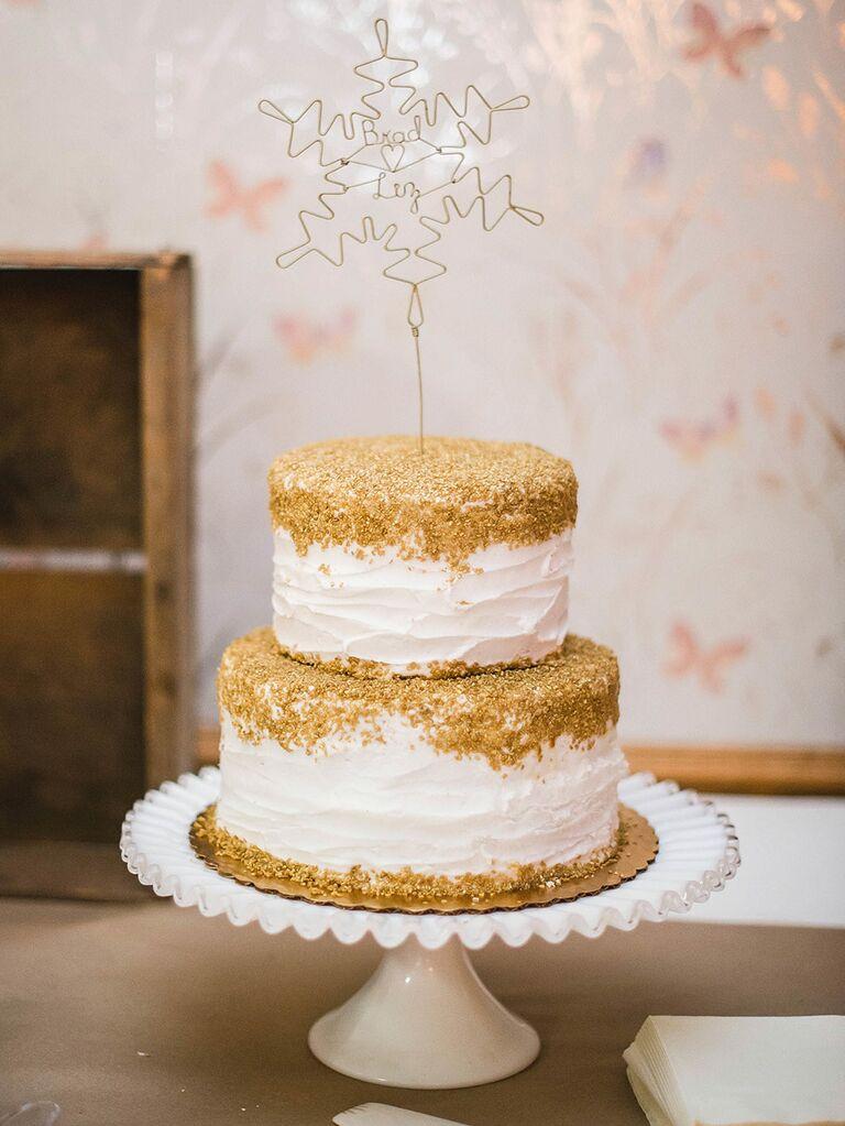 Winter wedding cake with snowflake cake topper