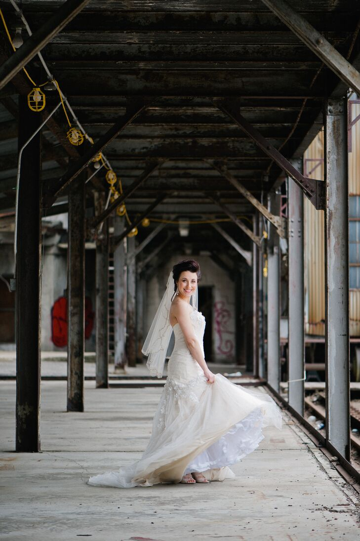 """""""My gown was a total surprise for me. I didn't know what look I was going for, but once I put that dress on I just didn't want to take it off. The color was a very unique light gold and ivory that I had never seen before. I knew I wanted to keep a little tradition with a veil for the ceremony. I couldn't take that 'lift the veil' moment away from my father. Plus — how many times in your life do get to wear a veil?"""" says Rachel."""