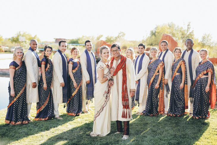 The bridesmaids wore blue and gold saris; the groomsmen wore a cream color palette.