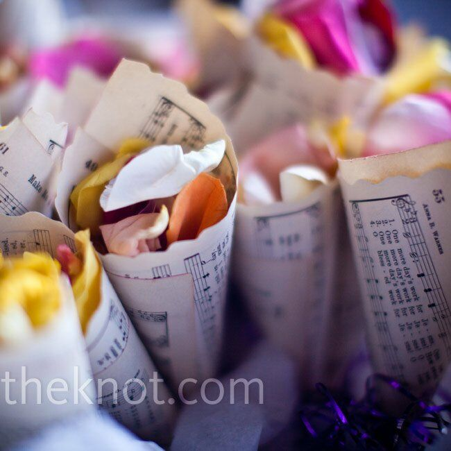 Cone-shaped pages (from joy's grandmother's old hymnal) were filled with rose petals, which guests tossed on Joy and Eric as they made their exit.