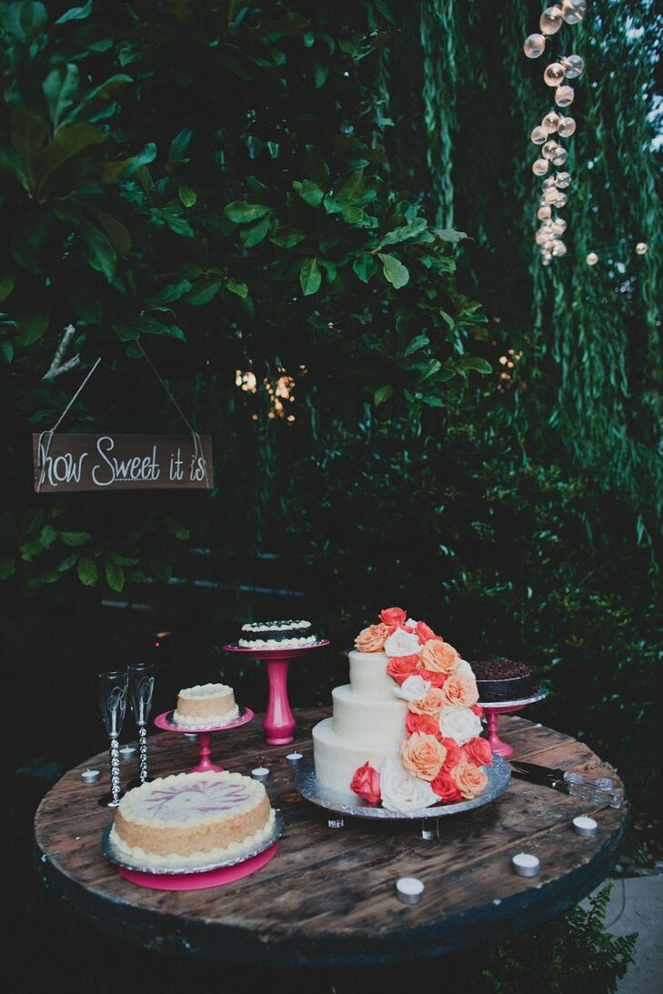 Kelsey and Tanner's chocolate and carrot flavored wedding cake was decorated with fresh colored roses.