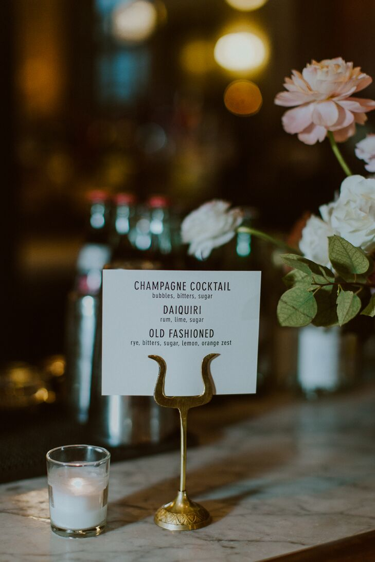 Lion by the Sun injected a sense of 1930s glamour into the soiree with simple yet elegant signs styled alongside brass holders.