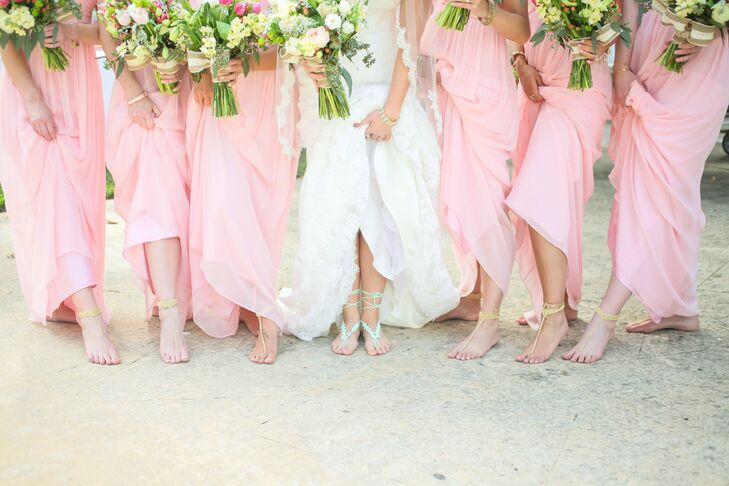 2ab973b434bb Each bridesmaid paired her blush floor-length dress with yellow crochet  barefoot sandals during the