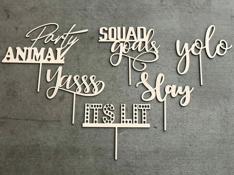 Laser cut photo booth props with funny slang