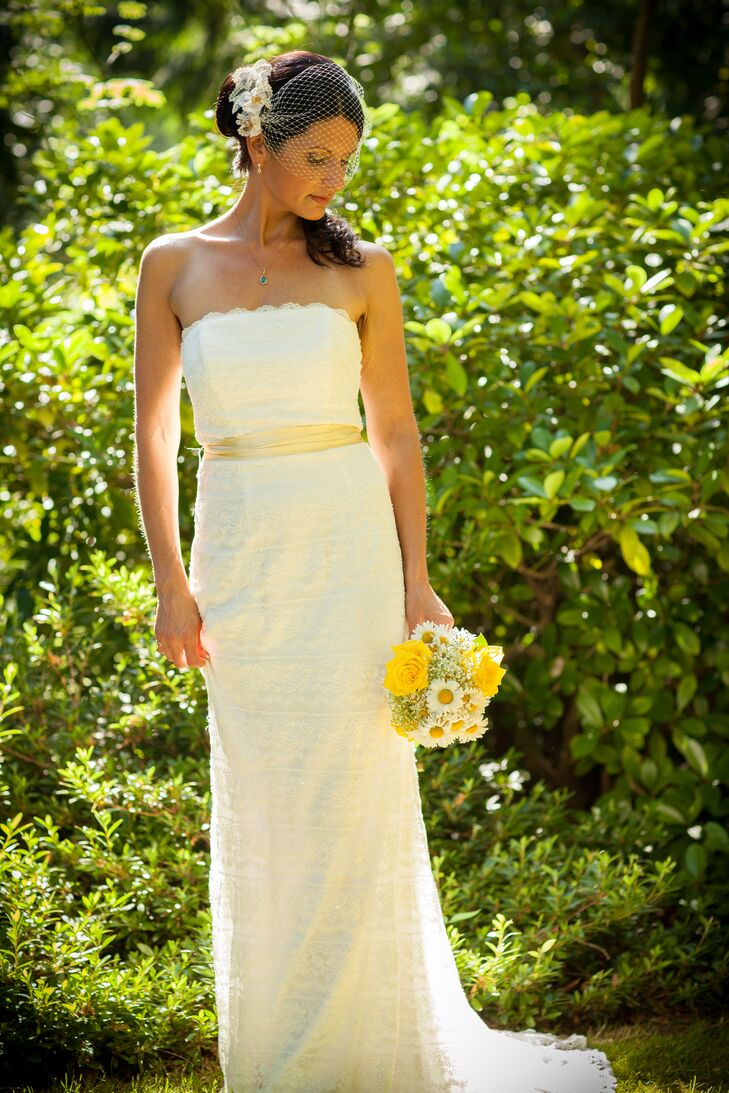 Jessica wore a strapless ivory wedding dress that was accented with a yellow belt.