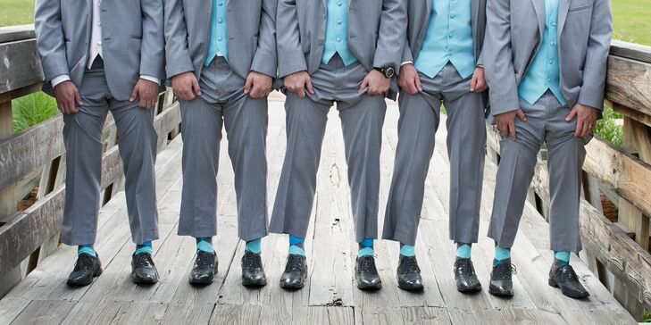 The groomsmen wore bright blue socks for an added pop of color.