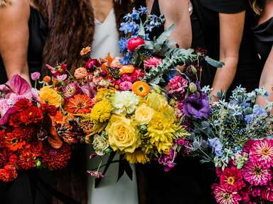 Bride and bridesmaids with rainbow bouquets