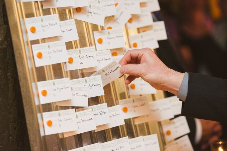 The escort cards had green detailing on the top and orange accents on the side to match the color palette. Guest names were handwritten onto each one.