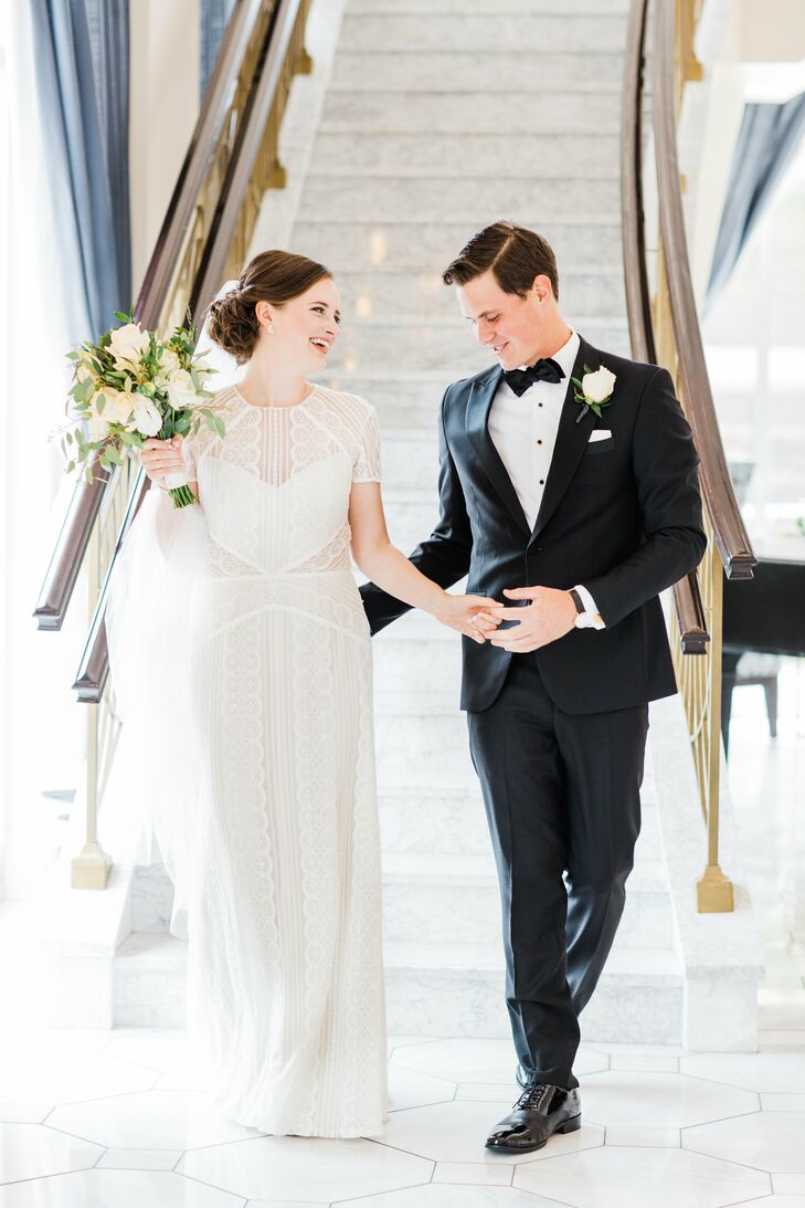 "When Hannah found her short-sleeve BHLDN dress, the elegant classic-meets-modern wedding theme began to come together. ""As soon as I tried it on, I could see our entire wedding: Jordan looking handsome in his tux and us dancing at the Figge,"" Hannah says."
