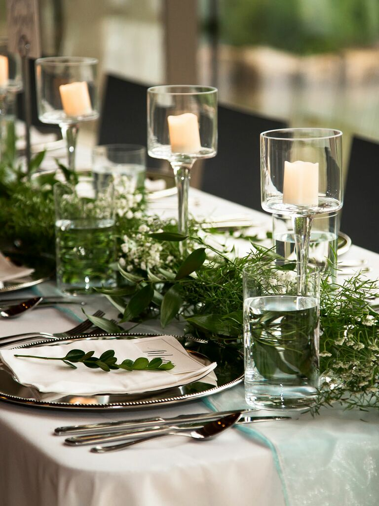 Romantic wedding centerpieces with candles diy wedding centerpiece with candles and green garlands junglespirit Image collections