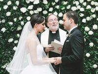 bride and groom and officiant at wedding ceremony