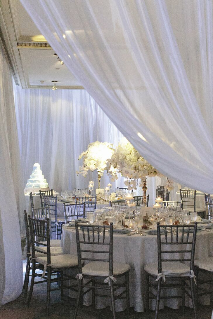 The reception space had a soothing, romantic feel with lush floral arrangements and white draped fabric throughout the room.